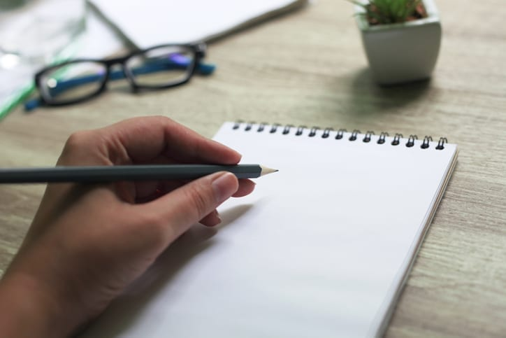 This is an image of someone writing with their left hand.