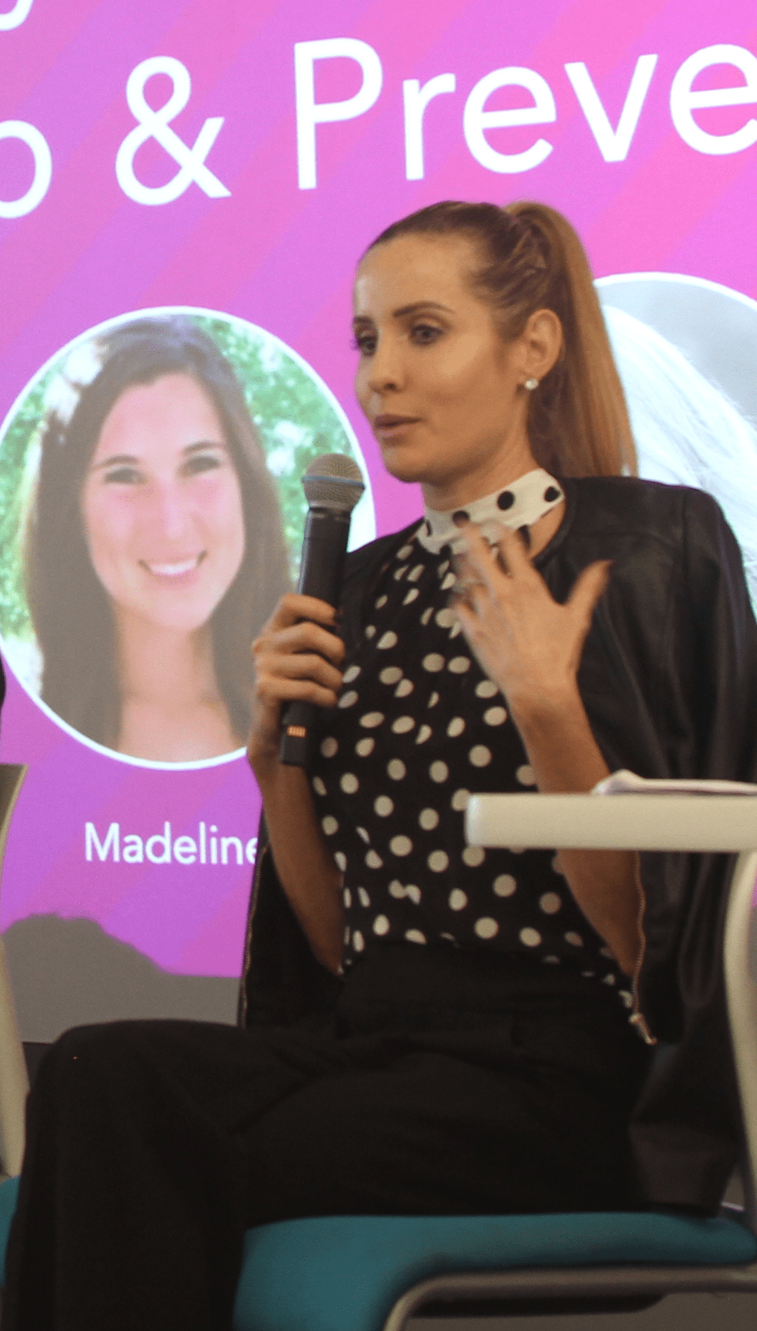 Laura speaking during a breast cancer awareness panel at 23andMe.